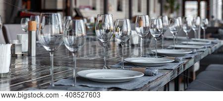 Modern Veranda Restaurant Interior, Banquet Setting, Glasses, Plates