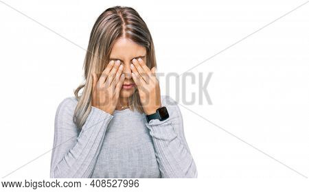 Beautiful blonde woman wearing casual clothes rubbing eyes for fatigue and headache, sleepy and tired expression. vision problem