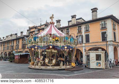 Brescia, Italy - December, 2015: Carousel Mary Go Round On Piazza Del Mercato Market Square In Bresc