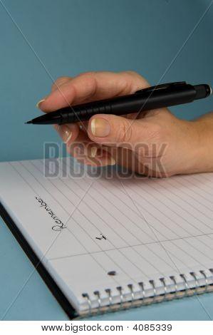 Hand Holding Pensil 2