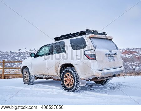 Fort Collins, CO, USA - February 15, 2021:  Toyota 4Runner SUV (2016 Trail edition) visiting Lory State Park at foothills of Rocky Mountains with a fresh snow.