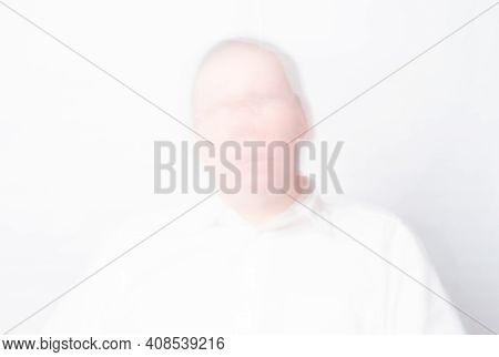 Mental Disorder Concept. Defocused Face Of Man With Schizophrenia Or Psychosis.
