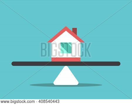 House In Middle Of Weight Scale On Turquoise Blue. Ownership, Property Division, Divorce, Real Estat