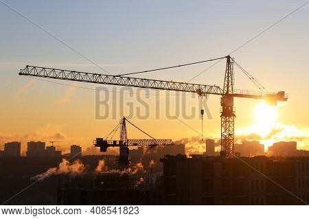 Construction Cranes And Unfinished Residential Buildings In Sunshine. Housing Construction, Real Est