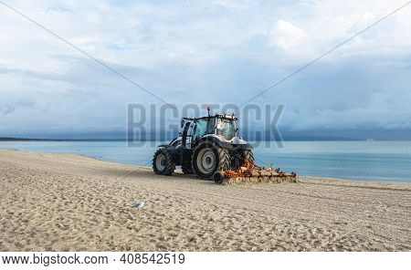 Morning Beach Scenery With Tractor Cleaning Sand, At Baltic Sea, On Rugen Island, Germany. Getting B