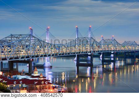 John F. Kennedy Bridge and Abraham Lincoln Bridge crossing the Ohio River into Louisville, Kentucky, USA at twilight.