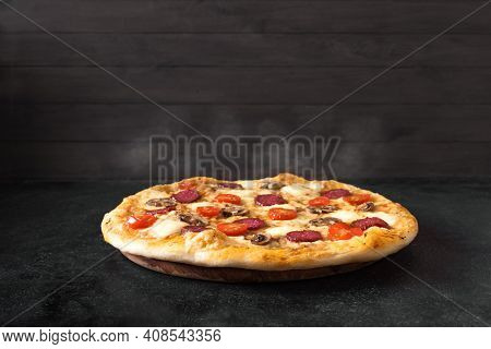 Supreme Pizza With Pepperoni, Mushrooms And Mozzarella Cheese Just From Oven, Copy Space. Fresh Home