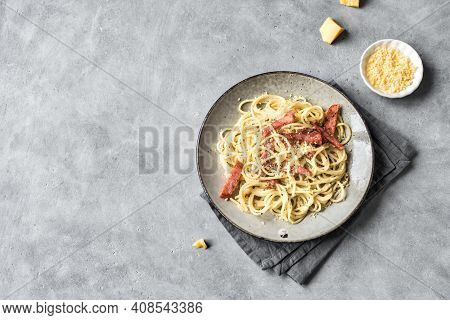 Spaghetti Carbonara On Gray Table.  Homemade Pasta With Bacon, Egg, Hard Parmesan Cheese And Cream S