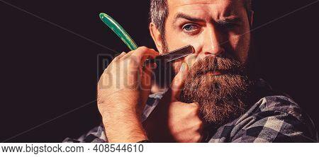 Man In Barbershop. Portrait Of Brutal Bearded Man. Vintage Straight Razor. Mens Haircut. Handsome Be