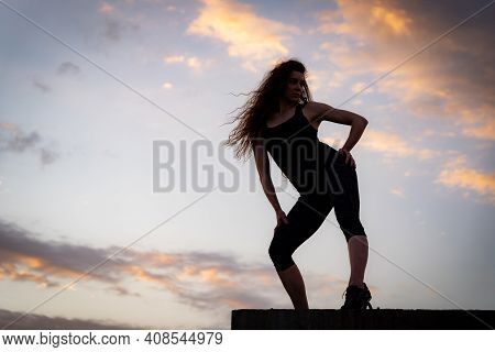 Female Dancer On The Edge Of Rooftop On The Sky Background. Concept Of Healthy Lifestyle, Talent And