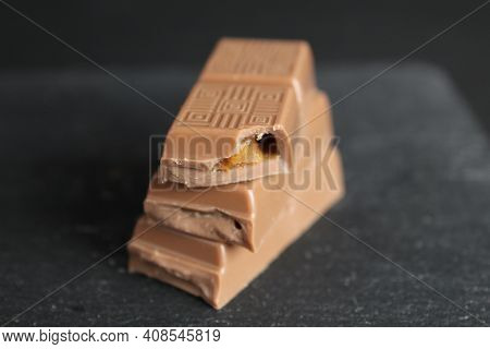 National Milk Chocolate Day Stock Images. Pile Of Chocolate With Nuts Images. Chocolate Isolated On