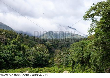 Volcano Mountain View In Green Forest Landscape. Cloudy Top Of Mountain. Tropical Island Hiking Adve