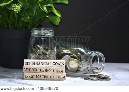 Text On Wood Block With Australian And European Coins On Table Surface With Dark Background - Set Fi