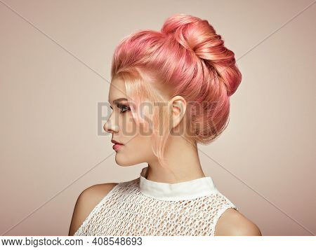 Blonde Girl With Elegant And Shiny Hairstyle. Beautiful Model Woman With Curly Hairstyle. Care And B