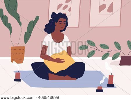 African American Woman Meditating And Performing Yoga At Home In Solitude. Relaxed Female Character