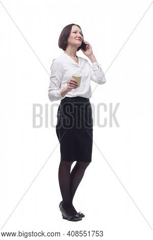 business woman with takeaway coffee talking on her mobile phone.