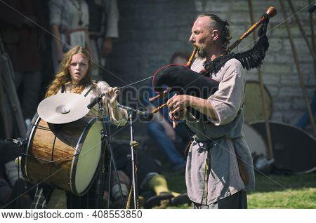 Staraya Ladoga, Saint-petersburg, Russia - June 22, 2019: Medieval Bagiper Plays The Bagpipes At A H