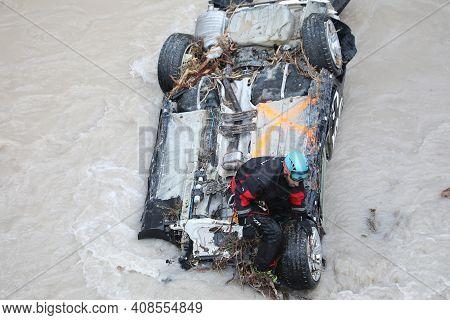 Breil-sur-roya, France - October 8, 2020: Rescuer Removing Debris On A Car In The Roya River After F