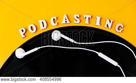 Podcasting Lettering And Vinyl Record Album, Headphones In Minimalistic Style On Yellow Background.