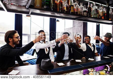 Cheers! Group Of Handsome Retro Well-dressed Man Gangsters Spend Time At Club. Drinking Whiskey At B