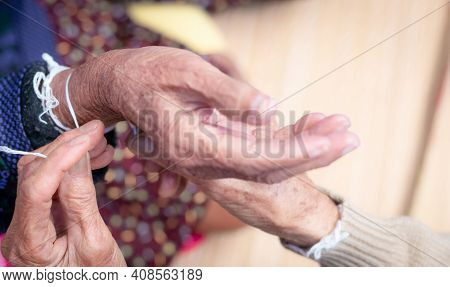 The Ceremony Of Binding Elderly People's Wrist With The Holy Thread To Console Old People's Kwan. Th