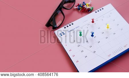 Calendar And Appointment Scheduler With A Pin On A Pink Background.