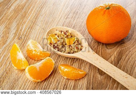 Slices Of Tangerine, Boiled Quinoa With Pieces Of Tangerines In Spoon, Tangerine On Wooden Table