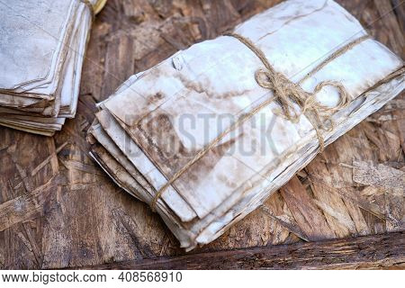 Set Of Dirty Dusty Old Antique Letters, Tied With Cord And Loop