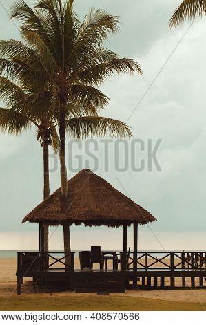 Wooden Gazebo Under Palm Trees On The Beach. Coastal Landscape Of Kota Kinabalu, Sabah, Malaysia. Ve