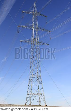 Electricity Pylon In The Blue Sky. Energy Transition Environment. Symbol For Electricity And Energy