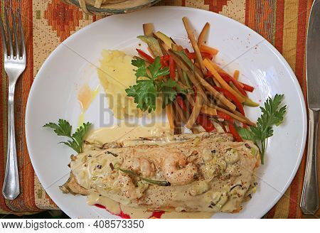 Top View Of Flavorful Pan-seared Lake Trout With Creamy Shrimp Sauce