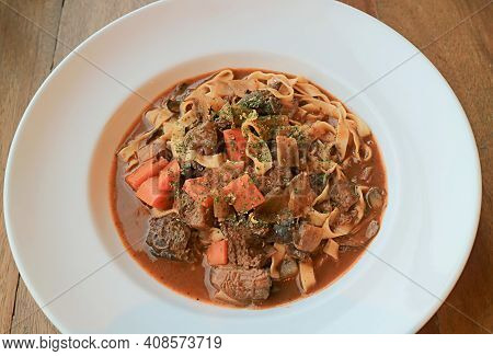 Plate Of Delectable Homemade Slow Cooked Beef Stew With Fettuccine