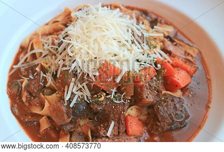 Mouthwatering Beef Stew Fettuccine Topped With Shredded Parmesan Cheese