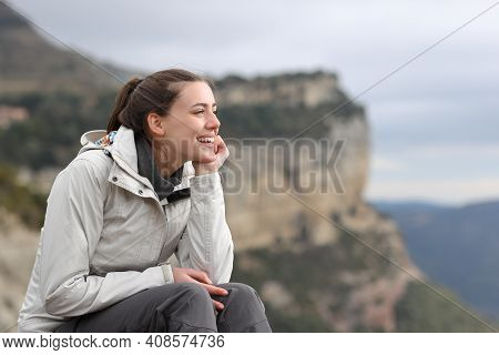 Happy Trekker Contemplating Views Sitting Outdoors In The Mountain
