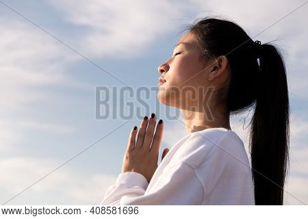 Portrait Of A Young Asian Woman Meditating At Sunrise, Relaxation And Mental Health Concept, Copyspa