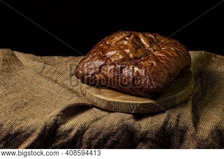 Black Bread On A Black Background. Borodino Bread. Homemade Baking. Bakery Product. Peasant Food