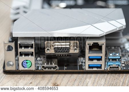 The Rear Panel Of A Desktop Computer Motherboard With Visible Connectors, Usb, Vga, Ps2 And Rj45 Net