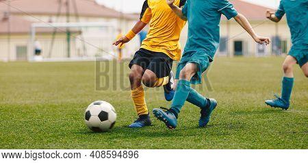 Running Footballers. Children Kicking Soccer School Tournament Match. Multiethnic Children Playing S