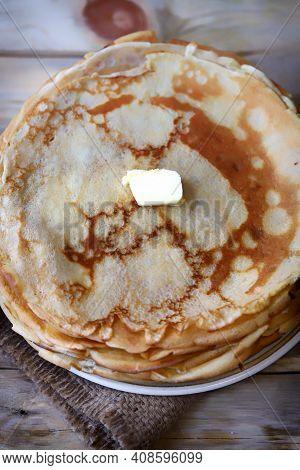 Homemade Pancakes. Cooking Pancakes For Shrovetide. Pancake Week.