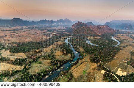 Panorama Of Vang Vieng Laos From Hot Air Balloon River And Mountain Range With Farmland Throughout