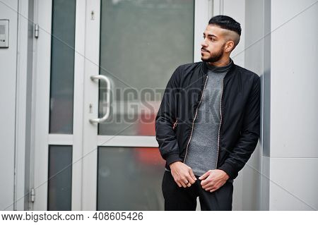 Portrait Of Stylish Arab Beard Man Wear Grey Turtleneck And Black Jaket. Arabian Model Guy.