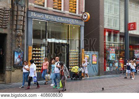 Amsterdam, Netherlands - July 10, 2017: People Visit A Cheese Store In Amsterdam. Netherlands Is Fam
