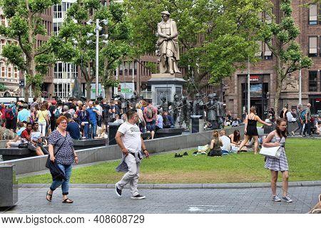 Amsterdam, Netherlands - July 10, 2017: People Visit Rembrandt Square (rembrandtplein) In Amsterdam.