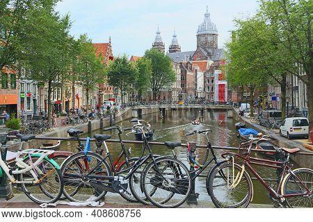 Amsterdam, Netherlands - July 8, 2017: People Visit De Wallen Red Light District In Amsterdam, Nethe