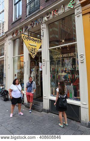Amsterdam, Netherlands - July 10, 2017: People Walk By Specialist Condom Shop Condomerie In Amsterda