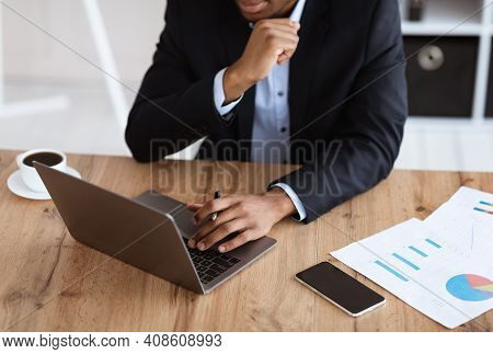 Cropped Of Black Businessman In Suit Working With Laptop In Office, Checking Marketing Report, Moder