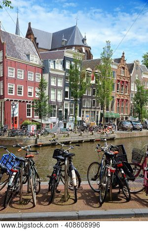 Amsterdam, Netherlands - July 10, 2017: Bicycles Parked By Herengracht Canal Side In Amsterdam, Neth