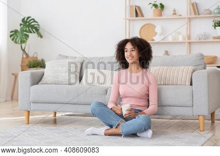 Pleasant Lazy Day, Calm Satisfied, Housewife Relaxing. Cheerful Serene Young African American Female