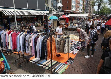Amsterdam, Netherlands - July 8, 2017: People Visit Waterlooplein Market In Amsterdam, Netherlands.