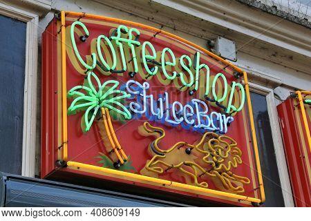 Amsterdam, Netherlands - July 8, 2017: Coffee Shop Neon Sign In Amsterdam, Netherlands. Coffeeshops